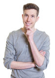 Australian guy with short hair in a grey shirt Royalty Free Stock Image
