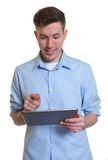 Australian guy working with tablet computer Stock Photos