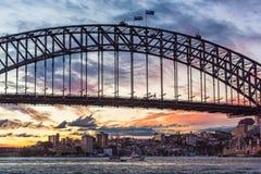 Australian iconic landmark Sydney Harbour Bridge against picturesque sunset sky Stock Images