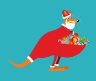 Australian Kangaroo Santa. Wallaby in Christmas cap. Gifts in ba. G. Santa Claus Australia. Marsupials bears gifts in pouch Stock Image