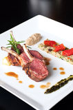 Australian lamb roasted with herbs and couscous Stock Image