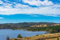 Australian landscape of lake, dam, and eucalyptus on hills. On sunny day. Australia Royalty Free Stock Photos