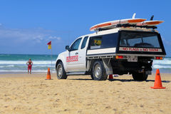 Australian Lifeguard vehicle with surfboard on beach Royalty Free Stock Photo