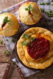 Australian meat pie on the table, vertical view from above Stock Photo