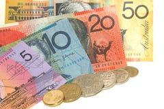 Australian money. Australian dollar bills and coins on plain white background stock image
