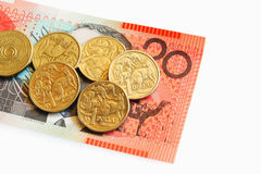 Australian Money. Australian One Dollar Coins on a Twenty Dollar Note stock images