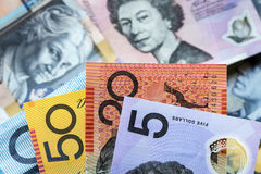 Australian Money Background. Focus on foreground, blurred faces beneath Royalty Free Stock Photo