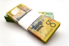 Australian Money. A bundle of an Australian one hundred dollar bill and fifty dollar bill with the fifty dollar bill bundle on top Royalty Free Stock Images