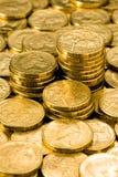 Australian Money Dollar Coins. Australian One dollar coins with golden lighting stock photos