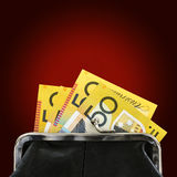 Australian Money in Purse over Red Background Royalty Free Stock Photo