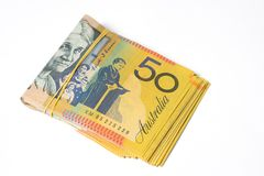 Stack of fifty Australian dollar bills on white background. Stock Images
