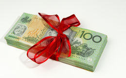Australian money gift. A bundle of Australian money bundle in detail tied up with ribbon as a gift. copyspace stock photo