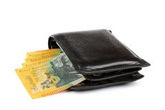 Australian Money in Wallet. Collection of Australian fifty dollar currency notes in a black male wallet on its side Stock Photography