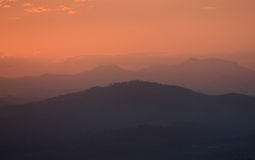 Australian mountain sunset. Sunset over a rainforest mountain range in Queensland, Australia Royalty Free Stock Images