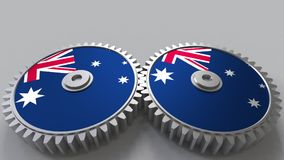 Australian national project. Flags of Australia on moving cogwheels. Conceptual 3D rendering. Australian national project. Flags of Australia on moving cogwheels Stock Image