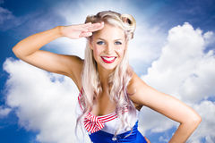 Australian Navy Girl Saluting Australia Day. Cloudy Blue Sky Portrait Of A Beautiful Blonde Australian Navy Girl With Beaming Smile Saluting With Hand To Royalty Free Stock Photos