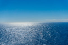 Australian ocean and sky. Perfect clear blue sky and calm sparkling ocean in sunny day Stock Photo