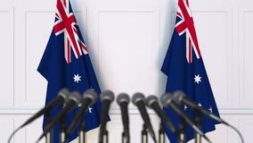 Australian official press conference. Flags of Australia and microphones. Conceptual 3D rendering. Australian official press conference. Flags of Australia and Stock Images