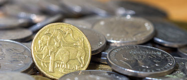 Australian One dollar close up stack coins cinematic crop Stock Photo