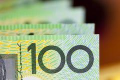 Australian One Hundred Dollar Bills. Blurred background Royalty Free Stock Images