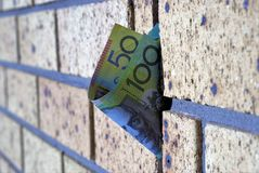 Australian one hundred dollar and fifty dollar note on wall. Selective focus. Australian money on wall. Fifty dollars and one hundred dollars in brick wall Royalty Free Stock Photo