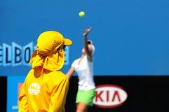 Australian Open Tennis. Ball boy watching a serve at Melbourne Australian Open Royalty Free Stock Image