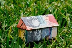 Australian Origami Money House on Lawn Royalty Free Stock Photos