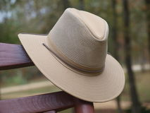 Australian outback hat on rocking chair. Australian outback hat hanging on rocking chair outdoors Stock Photo