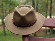 Australian outback hat on rocking chair. Australian outback hat hanging on rocking chair outdoors Stock Image