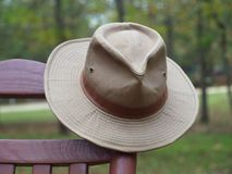 Australian outback hat on rocking chair. Australian outback hat hanging on rocking chair outdoors Royalty Free Stock Photos