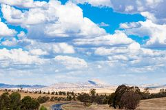 Australian outback landscape with distant hills and road. On sunny day Stock Photo