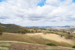 Australian outback landscape with hills and paddocks. Nature background Royalty Free Stock Images