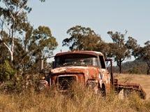 Australian outback rusty old farm truck. In paddock Stock Photo