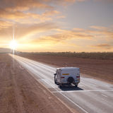 Australian Outback Touring Caravan. An Australian Outback touring caravan on the road in the early morning near Eucla, on the Western/South Australia border. The Royalty Free Stock Images