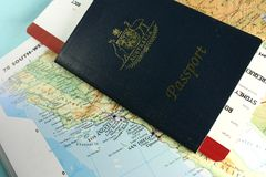 Australian Passport. With flight boarding pass, on map of USA west coast