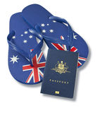 Travel Australian Passport Flag Thongs. An Australian passport with australian flag thongs on a white background Royalty Free Stock Photos