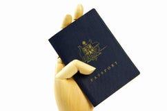 Australian passport and hand Royalty Free Stock Image