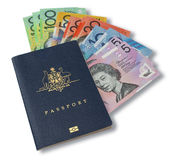 Australian Passport Money. An Australian passport with money fanning out on a white background Stock Photography