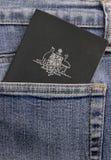 Australian passport in pocket. A current Australian passport in the back pocket of a pair of blue denim jeans Stock Photo