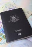 Australian passport on visa page background. Australian passport sitting on open passport pages showing visas Royalty Free Stock Photo