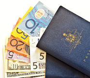 Australian passports and currency. 2 well worn Australian passports and currency from US, Europe and Australia. Copyspace Royalty Free Stock Photos