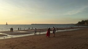 Australian people viewing a dramatic sunset at Mindil Beach in Darwin Norther