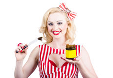 Australian pinup woman holding sandwich spread Royalty Free Stock Photos