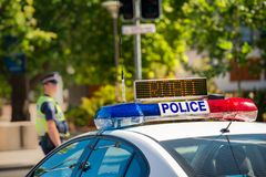 Australian police car. South Australian police car on street in Adelaide with policeman on the background stock photography