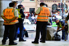 Australian Police. MELBOURNE,AUS - APR 14 2014:Victoria Policemen on duty.As of 2013, Victoria Police has over 12,539 members across 325 police stations.It has a stock photos