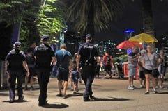 Australian Police Patrol At Night. Australian Police officers patrol in Southbank Parklands in Brisbane, Australia stock photo