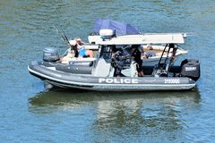 Australian Police Patrol Boat in Gold Coast Queensland Australia. Australian Police patrol boat checks motor boats on the rivers of Gold Coast, Queensland stock image