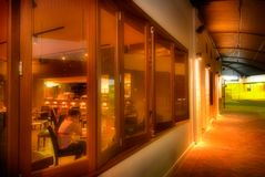 Australian Pub at night. A quiet evening in Rockhampton,Queensland,Australia. View along Quay Street of both the inside and outside of The Heritage Hotel Stock Images