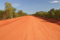 Australian rural road. Blue clear sky over the red Australian rural road Royalty Free Stock Photography