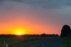 Australian rural road near Ballarat at sunset Royalty Free Stock Photo